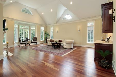 hardwood: Family room in luxury home with curved windows
