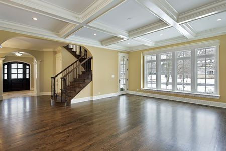 hardwood: Family room in new construction home with view into foyer