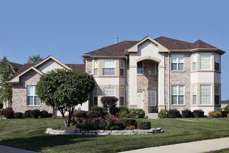 Luxury home in suburbs with two column arched entry Stock Photo - 6739273