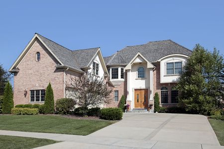 Large suburban brick home with arched entry Stock Photo - 6739049