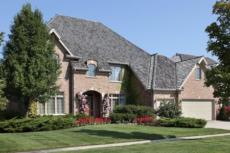 Brick home in suburbs with three car garage Stock Photo - 6739320
