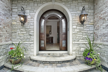 front door: Arched stone entry of luxury suburban home