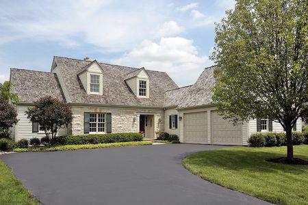 Suburban stone home with cedar shake roof Stock Photo - 6739354