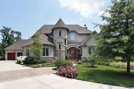 Luxury home in suburbs with front turret photo