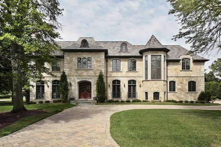 luxury house: Luxury stone home in suburbs with turret