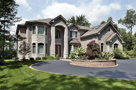 driveways: Luxury brick and stone home with arched entry