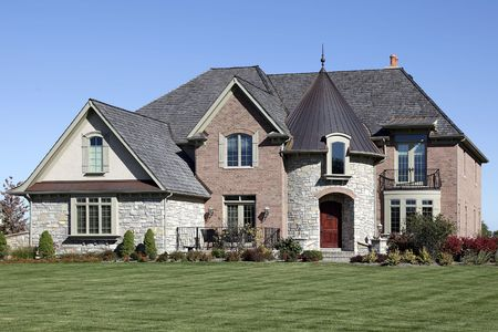 Luxury brick, stone and cedar home with turret Stock Photo - 6739195