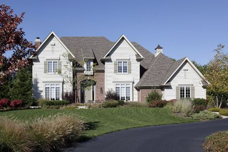 Luxury home in suburbs with circular driveway Stock Photo - 6739292