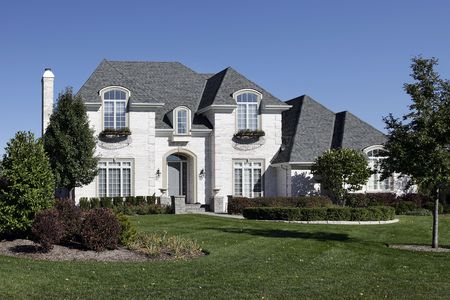 White brick home in suburbs with arched entry Stock Photo - 6739310