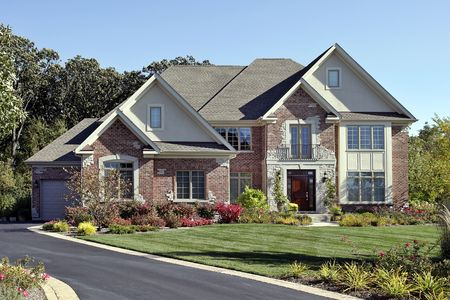 Brick home in suburbs with front balcony photo
