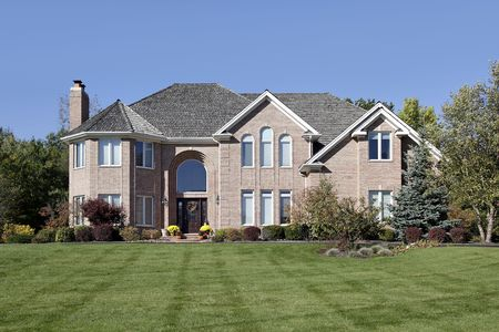 Large brick home in suburbs with arched entry Stock Photo - 6739306