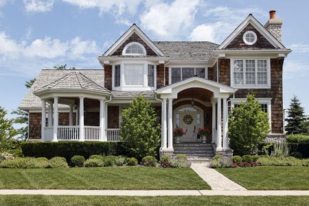 wood lawn: Luxury home in suburbs with column entry way Stock Photo