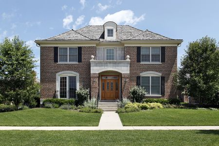 Brick home in suburbs with front door archway photo