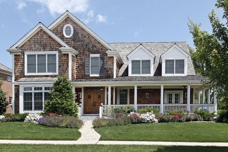 flowered: Suburban home with flowered landscaping and front porch Stock Photo