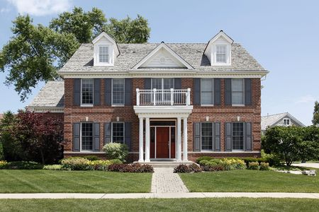 Brick home with columned entry and front balcony Stock Photo - 6739362