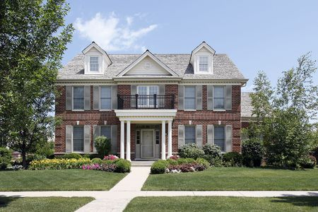 Brick home with columned entry and front balcony Stock Photo - 6739358