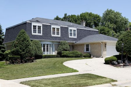 front house: Suburban home with circular drive and brick garage