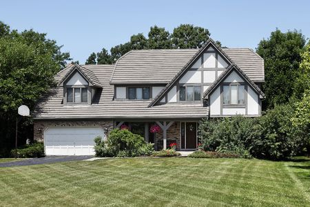 Tudor home in suburbs with front porch photo