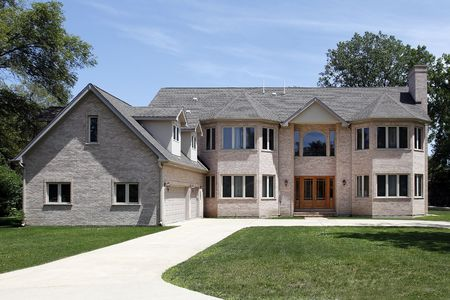 Large brick home in suburbs with three car garage Stock Photo - 6739407