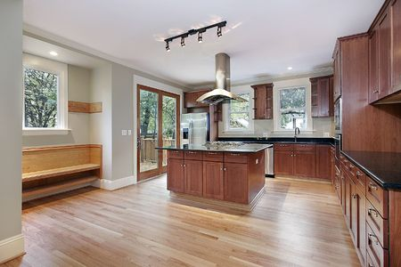 Kitchen in new construction home with island Stock Photo - 6738766