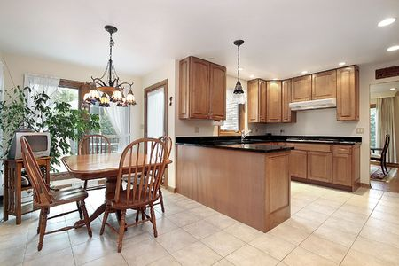 kitchen furniture: Kitchen in suburban home with eating area