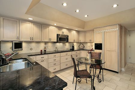 cabinetry: Kitchen in townhouse with light oak cabinetry
