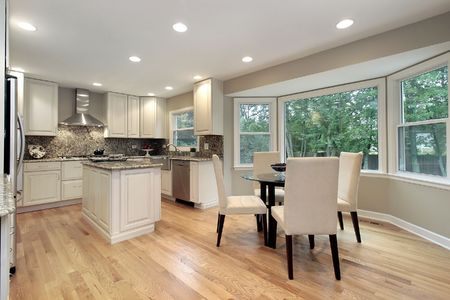 lighting fixtures: Kitchen in suburban home with eating area