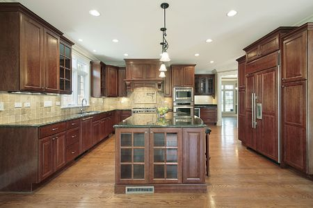 cabinetry: Kitchen in new construction home with cherry cabinetry