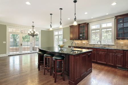 kitchen island: Kitchen in new construction home with island and stools Stock Photo