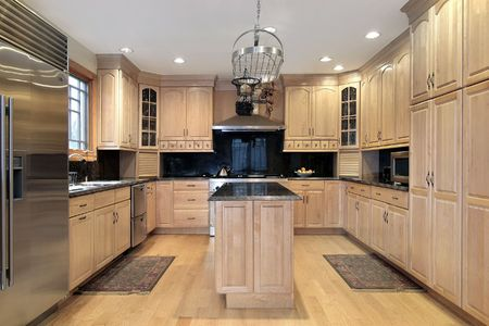 Kitchen in new construction home with oak wood cabinetry photo