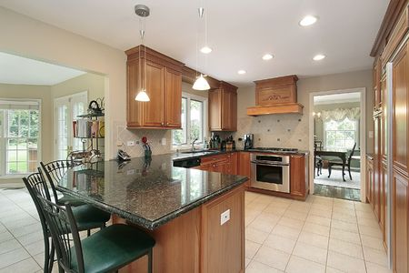 island: Kitchen in suburban home with granite island