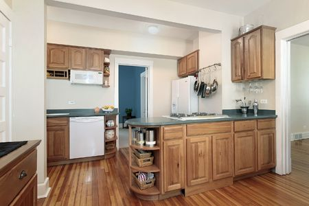 Kitchen in suburban home with oak wood cabinetry Stock Photo - 6738728