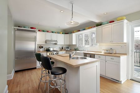 Kitchen in suburban home with wood island photo