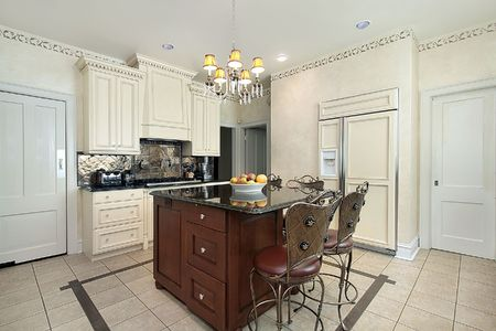 Kitchen in luxury home with wood and granite island photo