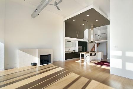 lighting fixtures: Cocina contempor�nea en condominio con vista de sala de familia
