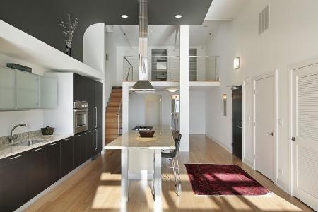 Contemporary kitchen in condominium with granite island photo
