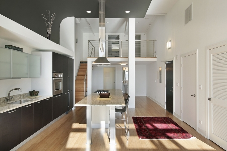 granite: Contemporary kitchen in condominium with granite island