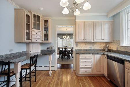 Kitchen in suburban home with wood cabinetry photo