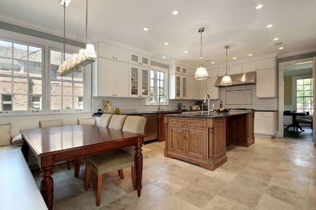 Kitchen in new construction home with eating area and bench photo