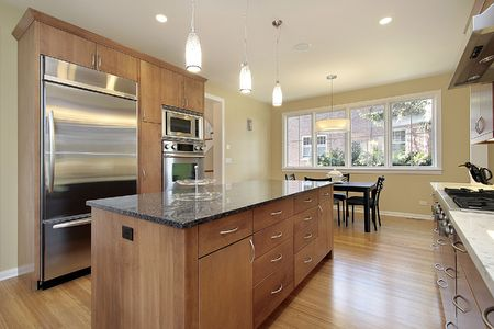 fixtures: Kitchen in upscale home with eating area
