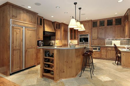 contemporary kitchen: Contemporary kitchen with wood cabinets and refrigerator Stock Photo