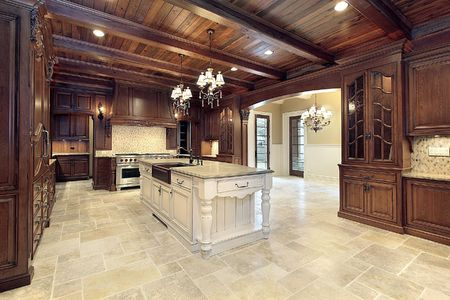 Upscale kitchen in new construction home with wood ceilings