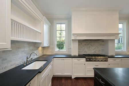 Kitchen in new construction home with black countertops photo
