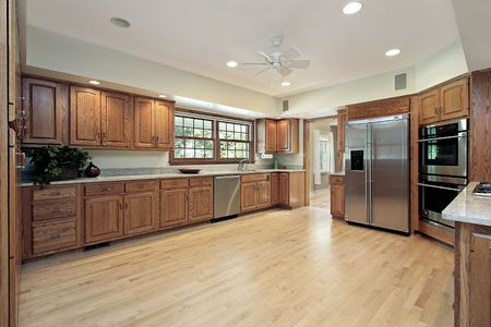 6738358: Kitchen in suburban home with oak wood cabinetry Stock Photo