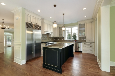 Kitchen in new construction home with black island photo