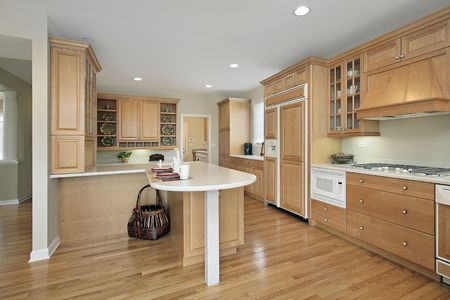 Kitchen in suburban home with oak cabinetry Stock Photo - 6738691
