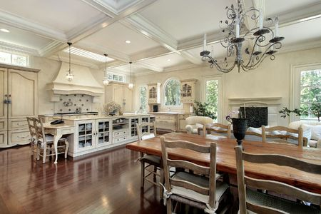 island: Large upscale suburban kitchen with white island