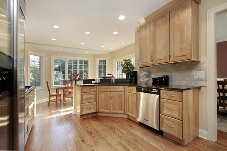 Kitchen in suburban home with oak cabinetry photo