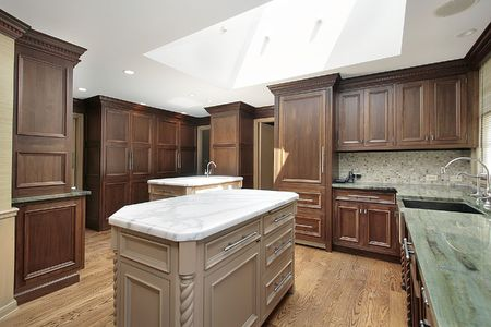 Kitchen in luxury home with white marble island photo