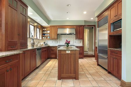 cabinetry: Kitchen in upscale home with wood cabinetry